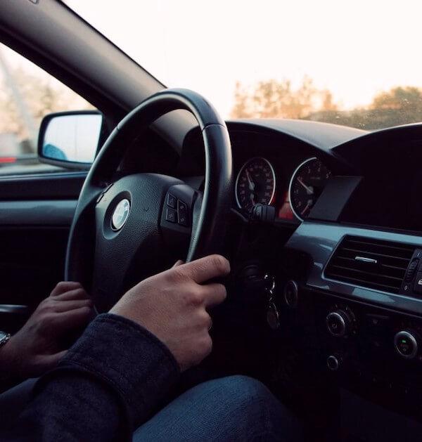 man driving BMW