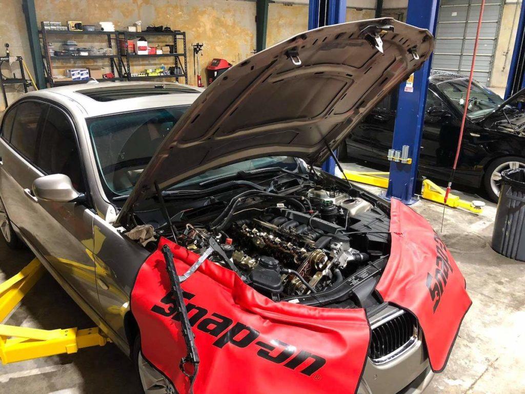 oil leak repair BMW 328i mechanic shop